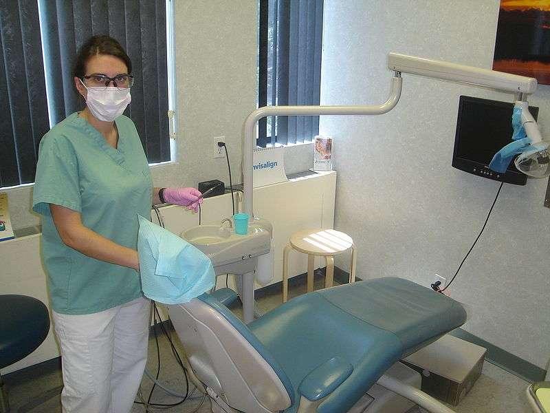 dental hygienist in treatment room